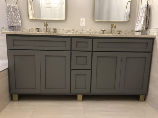 "Custom maple bathroom vanity for a customer in Emerson finished in ""Metro Grey"" with metallic gold feet."